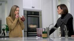 In this Jan. 10, 2020 image from video, 18-year-old Nina Nichols takes her daily dose of Palforzia as her mother, Maria Acebal watches, in her home in Washington