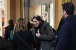 In this photo taken on Thursday, Jan. 30, 2020, Elly Schlein talks with people on a street after an interview with the Associated Press in downtown Bologna, Italy