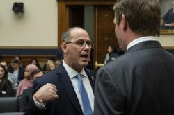 Fred Guttenberg, left, whose daughter was killed in the Parkland, Fla., school shooting, talks with Rep. Eric Swalwell, D-Calif., before FBI Director Christopher Wray testifies during an oversight hearing of the House Judiciary Committee, on Capitol Hill, Wednesday, Feb. 5, 2020 in Washington