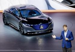 In this Tuesday, Sept. 10, 2019 file photo Ola Kaellenius, CEO of the car manufacturer Mercedes, stands next to a 'Vision EQS' car at the IAA Auto Show in Frankfurt, Germany