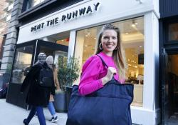 "Vara Pikor poses for a picture in front of a ""Rent The Runway"" store before returning some items in New York."
