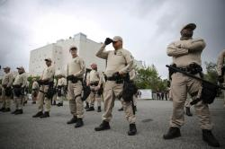 In this Oct. 19, 2017 photo, Troopers with the Florida Highway Patrol Quick Response Force line in front of the Phillips Center on the University of Florida campus in Gainesville, Fla., ahead of white nationalist Richard Spencer's speech