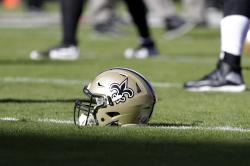 In this Oct. 23, 2016, file photo, a New Orleans Saints helmet rests on the playing field before an NFL football game in Kansas City, Mo.