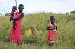 In this photo taken Monday, Oct. 1, 2018, children stand in a field by the side of the road between Melut and in Paloch town, in South Sudan