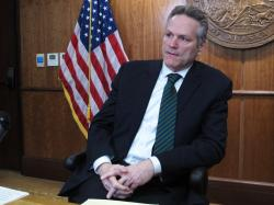 In this Jan. 31, 2020 photo, Alaska Gov. Mike Dunleavy speaks to reporters in Juneau, Alaska. On Wednesday, Feb. 12, Dunleavy proposed a state lottery as a way to provide a new source of revenue