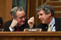 Senate Banking Committee Chairman Sen. Mike Crapo, R-Idaho, left, talks with ranking member Sen. Sherrod Brown, D-Ohio, right, during a hearing with Federal Reserve Chairman Jerome Powell on Capitol Hill in Washington, Wednesday, Feb. 12, 2020