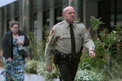 St. Louis County police Sgt. Keith Wildhaber returns from a lunch break to the St. Louis County courthouse on the third day of his discrimination case against the county in Clayton, Mo.