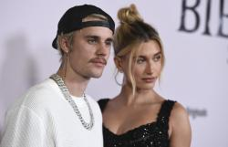 "Justin Bieber and Hailey Baldwin arrive at the Los Angeles premiere of ""Justin Bieber: Seasons."""