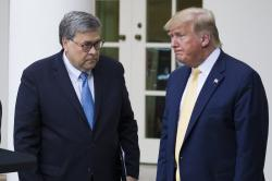 "In this July 11, 2019, file photo, Attorney General William Barr, left, and President Donald Trump turn to leave after speaking in the Rose Garden of the White House, in Washington. Attorney General William Barr took a public swipe Thursday at President Donald Trump, saying that the president's tweets about Justice Department prosecutors and cases ""make it impossible for me to do my job."""