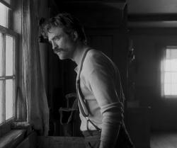 """Robert Pattinson in a scene from """"The Lighthouse."""""""