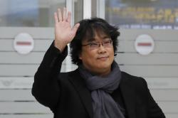 South Korean director Bong Joon-ho waves upon his arrival at the Incheon International Airport in Incheon, South Korea.