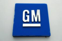 This Jan. 27, 2020, file photo shows a General Motors logo at the General Motors Detroit-Hamtramck Assembly plant in Hamtramck, Mich.