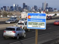 In this Feb. 6, 2020, photo, a Clean Colorado highway sign sponsored by the Northern Lights Cannabis Co. is displayed on eastbound 6th Avenue west of Sheridan Blvd. in Denver