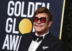 In this Jan. 5, 2020 file photo, Elton John arrives at the 77th annual Golden Globe Awards at the Beverly Hilton Hotel, in Beverly Hills, Calif.