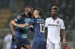 Porto's Moussa Marega, from Mali, left, leaves the pitch during a Portuguese league soccer match between Vitoria SC and FC Porto in Guimaraes, Portugal, Sunday, Feb. 15, 2020