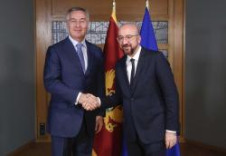 Montenegro's President Milo Dukanovic, left, is welcomed by European Council President Charles Michel prior to a meeting at the Europa building in Brussels, Monday, Feb. 17, 2020