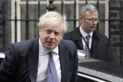 Britain's Prime Minister Boris Johnson arrives at 10 Downing Street in London, Thursday, Feb. 13, 2020