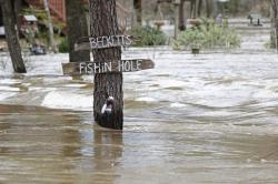 Water from the Pearl River floods Florence-Byram Road near Byram, Miss, Monday, Feb. 17, 2020