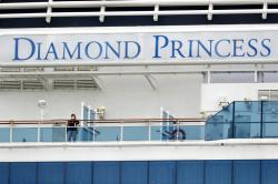 Passengers speak on balconies of the quarantined Diamond Princess cruise ship.