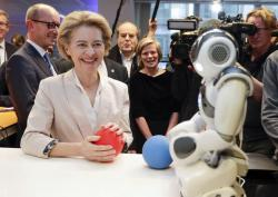 President of the European Commission Ursula von der Leyen looks at the invention 'Do you Speak Robot?' at the AI Xperience Center at the VUB (Vrije Universiteit Brussel) in Brussels, Tuesday, Feb. 18. 2020
