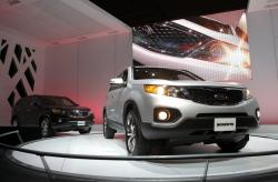 In this Dec. 2, 2009, file photo, the 2011 Kia Sorento debuts at the Los Angeles Auto Show in Los Angeles
