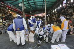 Workers wearing protective gears prepare to spray disinfectant as a precaution against the coronavirus at Namdaemun Market in Seoul, South Korea.