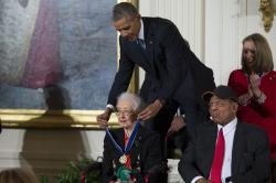 Willie Mays, right, looks on as President Barack Obama presents the Presidential Medal of Freedom to NASA mathematician Katherine Johnson during a ceremony in the East Room of the White House.