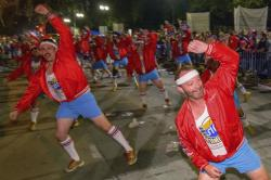 The 610 Stompers, a dancing group who claim to be ordinary men with extraordinary moves, dance on Napoleon Ave. in the Krewe of Orpheus parade during Mardi Gras celebrations in New Orleans.