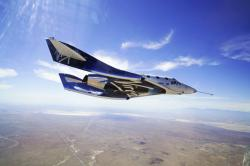 In this May 29, 2018 photo provided by Virgin Galactic, the VSS Unity craft flies during a supersonic flight test