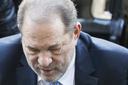 Harvey Weinstein arrives at a Manhattan courthouse for his rape trial in New York.