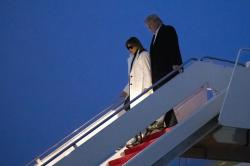 President Donald Trump, and first lady Melania Trump, step off Air Force One upon arrival.