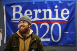 In this March 3, 2020, photo, Jonah Hahn, a supporter of Democratic presidential candidate Sen. Bernie Sanders, I-Vt.