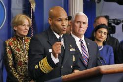 In this March 9, 2020, photo Surgeon General Jerome Adams speaks in the briefing room of the White House in Washington about the coronavirus outbreak