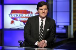 "Tucker Carlson, host of ""Tucker Carlson Tonight,"" poses for photos in a Fox News Channel studio, in New York."