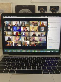 In this March 16, 2020 photo provided by Jamie Lee Finch, a laptop on a desk in Nashville, Tenn., showing people gathered together online for a virtual happy hour is shown