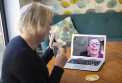 Helen Walters, left, talks to her mother Gillian using video calling, as people find alternative ways to celebrate Mother's Day to limit the potential spread of COVID-19 coronavirus, in London, Sunday March 22, 2020