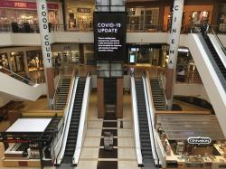 Few shoppers were in the St. Louis Galleria on Thursday, March 19, 2020. Most stores were shuttered
