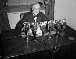 In this Feb. 27, 1941 file photo President Franklin D. Roosevelt speaks on the radio from the Oval Room of the White House