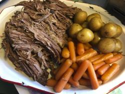 This image released by Kim Bierly shows a pot roast dinner with carrots and potatoes, made in a slow cooker.