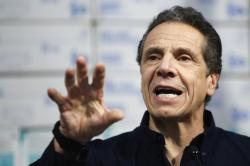 New York Gov. Andrew Cuomo speaks during a news conference against a backdrop of medical supplies at the Jacob Javits Center that will house a temporary hospital in response to the COVID-19 outbreak, Tuesday, March 24, 2020, in New York