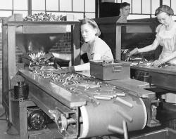 In this June 26, 1942, file photo, women workers at the St. Louis Ordnance plant inspect 50 calibre shell casings
