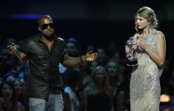 "Kanye West takes the microphone from singer Taylor Swift as she accepts the ""Best Female Video"" award during the MTV Video Music Awards in New York."