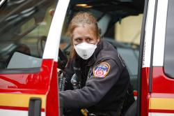 An FDNY medical worker wears personal protective equipment outside a COVID-19 testing site at Elmhurst Hospital Center.