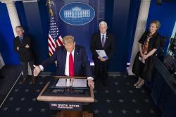 In this March 26, 2020, file photo President Donald Trump speaks about the coronavirus accompanied by Dr. Anthony Fauci, left, director of the National Institute of Allergy and Infectious Diseases, Vice President Mike Pence, and Dr. Deborah Birx, White House coronavirus response coordinator, in the James Brady Briefing Room in Washington