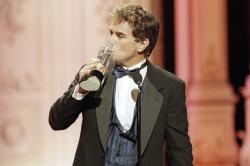 "In this Friday, Feb. 27, 1998 file photo, John Callahan of ""All My Children"" kisses his award after winning Outstanding Lead Actor at the Soap Opera Digest Awards in Universal City, Calif."