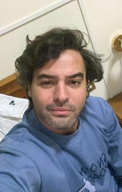 Andrea Napoli, 33, takes a selfie in a hotel being used for patients recovering from coronavirus, in Rome, Sunday, March 29, 2020.