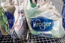 In this June 15, 2017, file photo, bagged purchases from the Kroger grocery store in Flowood, Miss., sit inside this shopping cart