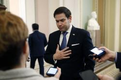 Sen. Marco Rubio, R-Fla., speaks with reporters on Capitol Hill in Washington, Tuesday, March 24, 2020, as the Senate works to pass a coronavirus relief bill