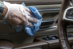 Common touch points are wiped down in the interior of a vehicle, which is one way to reduce the risk of spreading the coronavirus inside the cabin.