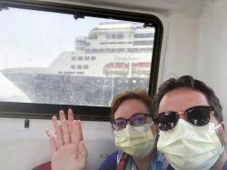 Laura Gabaroni and her husband Juan Huergo take a selfie on board a tender after they were evacuated from the Zaandam, a Holland American cruise ship.